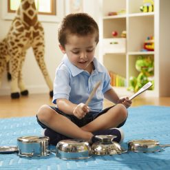 kid playing with pots and pans