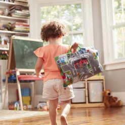 Child carrying the travel play mat