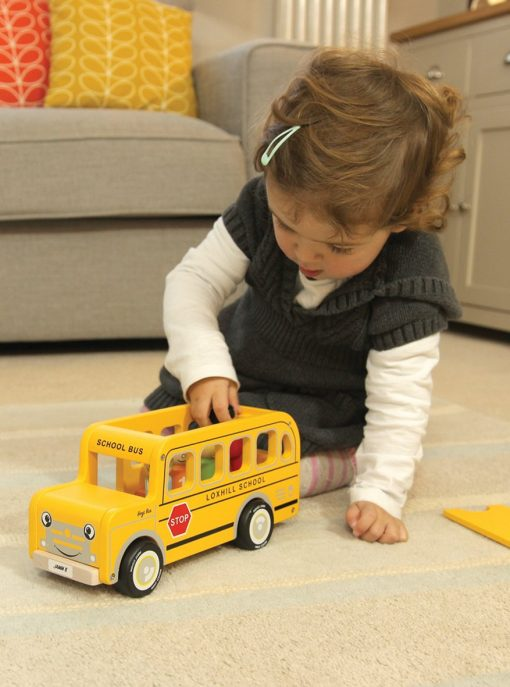 Kid playing with this indigo jamm school bus