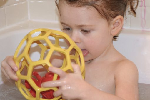 Toddler Playing With Bathtub Ball