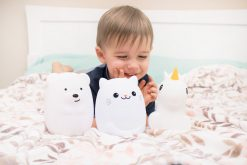 Boy Playing with LumiPets Bear, Cat, and Unicorn Nightlight with Remote