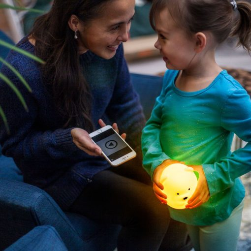 Girl Playing Music on her LumiPets Bear Nightlight with Remote and Bluetooth