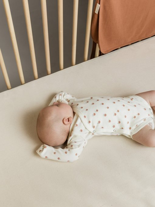 Organic Cotton Side-Snap foldover onesie with peach pattern