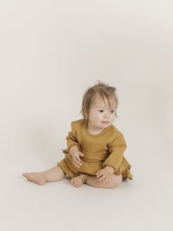 Ochre Romper with Ruffle Skirt by Quincy Mae