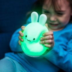 Girl Squeezing LumiPets Bunny Nightlight with Remote and Bluetooth