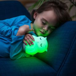 Girl Sleeping with LumiPets Owl Nightlight with Remote and Bluetooth