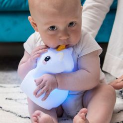 Baby Chewing on LumiPets Unicorn Nightlight with Remote