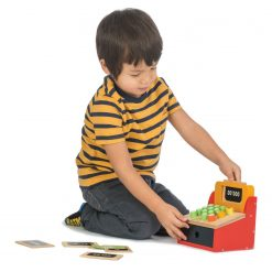 Boy Playing Money Till Red