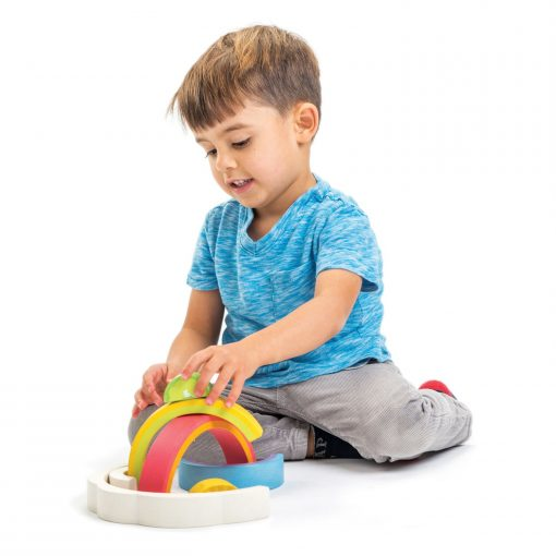 Kid playing with rainbow stacking toy