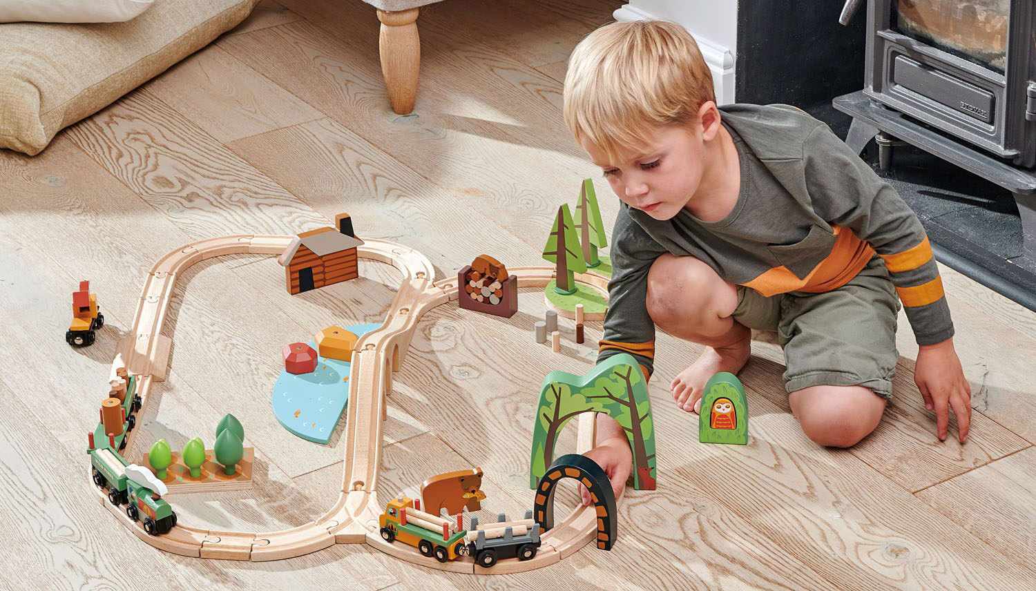 Toddler Boy Playing with Wooden Train Set