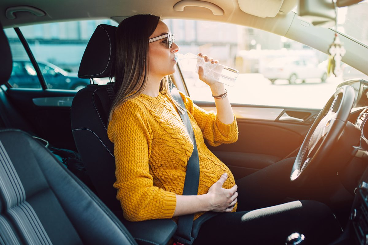 Pregnant Woman in a Car Wearing a Seat Belt
